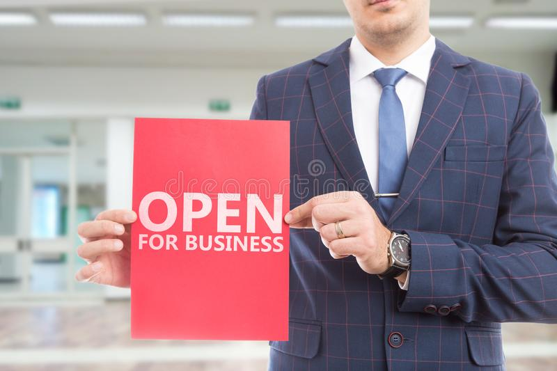 Man presenting paper with open for business text stock photography