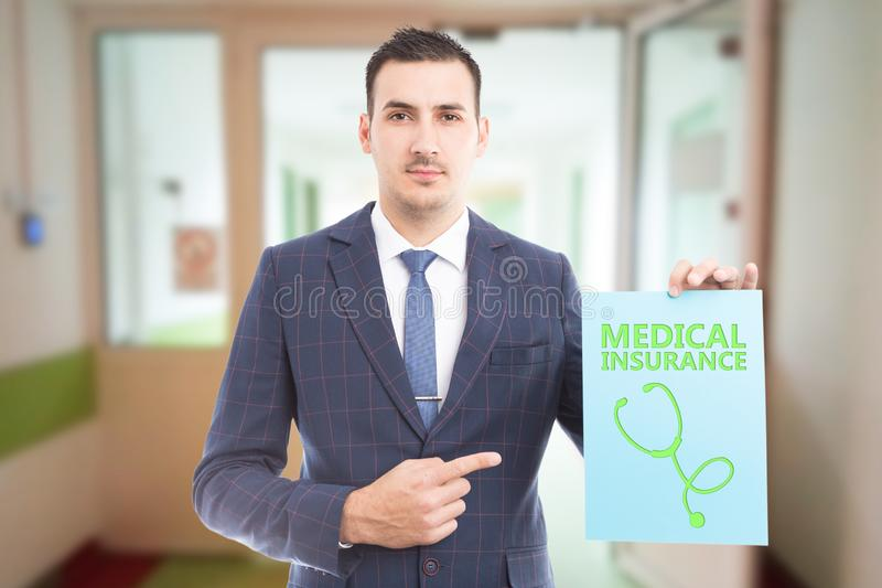 Man presenting paper sign with medical insurance stock photo