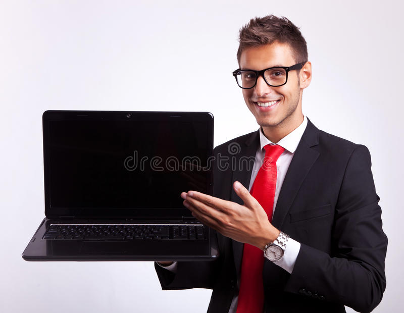Man Presenting You With A New Laptop Royalty Free Stock Image
