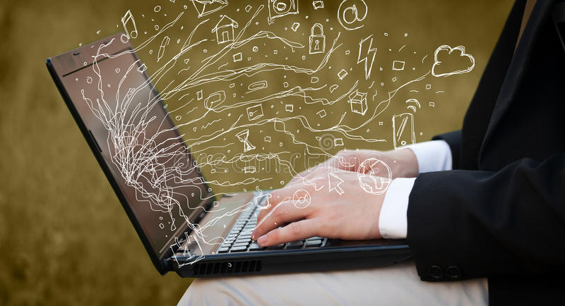 Man pressing notebook laptop computer with doodle icon cloud symbols stock image