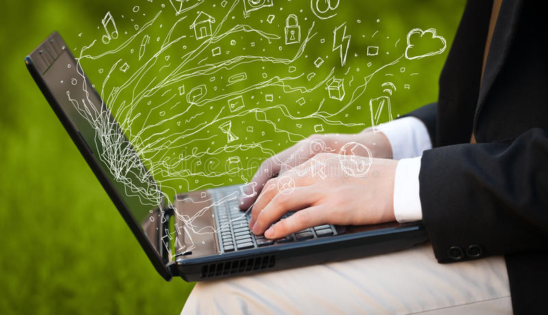 Man pressing notebook laptop computer with doodle icon cloud symbols. Man pressing notebook laptop computer with doodle icon media cloud symbols stock photo