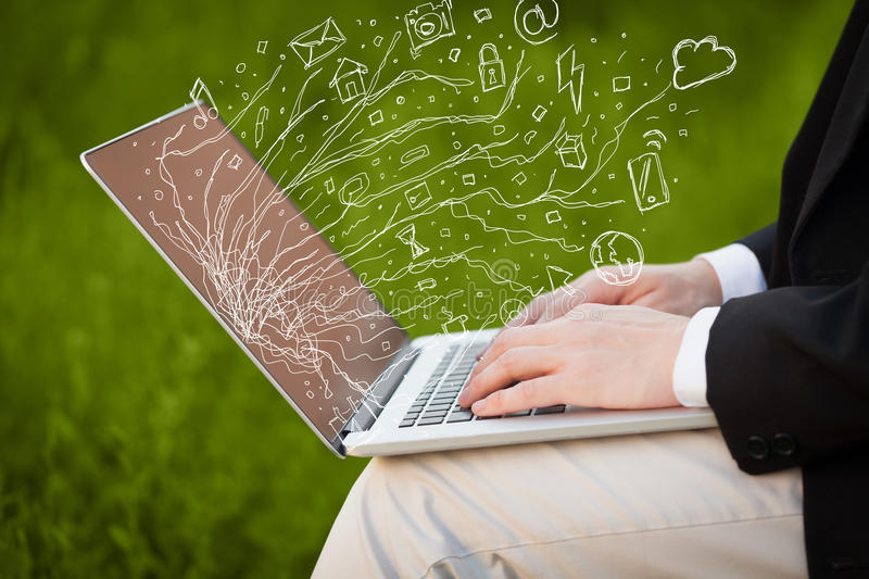 Man pressing notebook laptop computer with doodle icon cloud symbols. Man pressing notebook laptop computer with doodle icon media cloud symbols royalty free stock photography