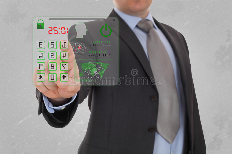 Man pressing the security code. Man pressing the security code in office stock image