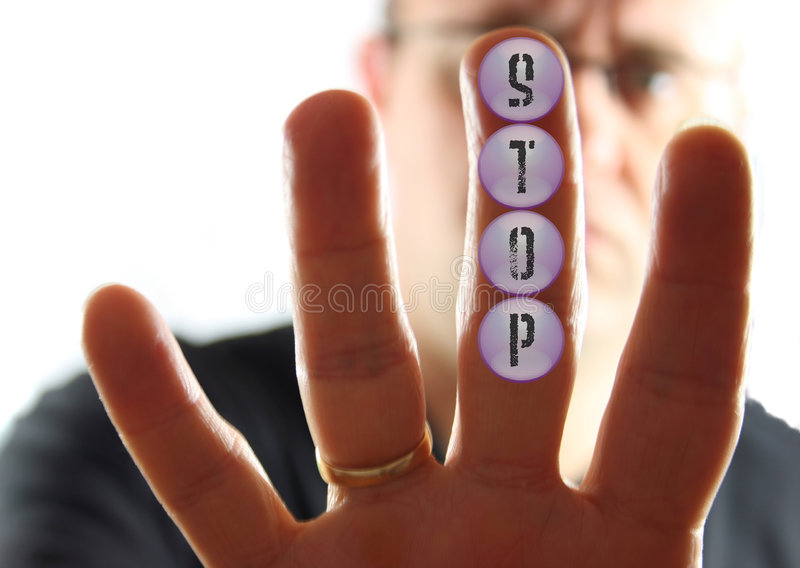 Man Pressing Stop Buttons. Man Pressing the Stop Button royalty free stock photo