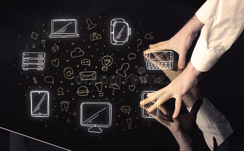 Man pressing table tablet hand touch interface with media icons stock image