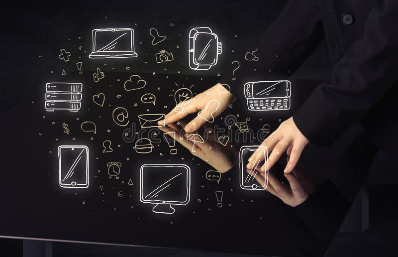 Man pressing table tablet hand touch interface with media icons royalty free stock photo