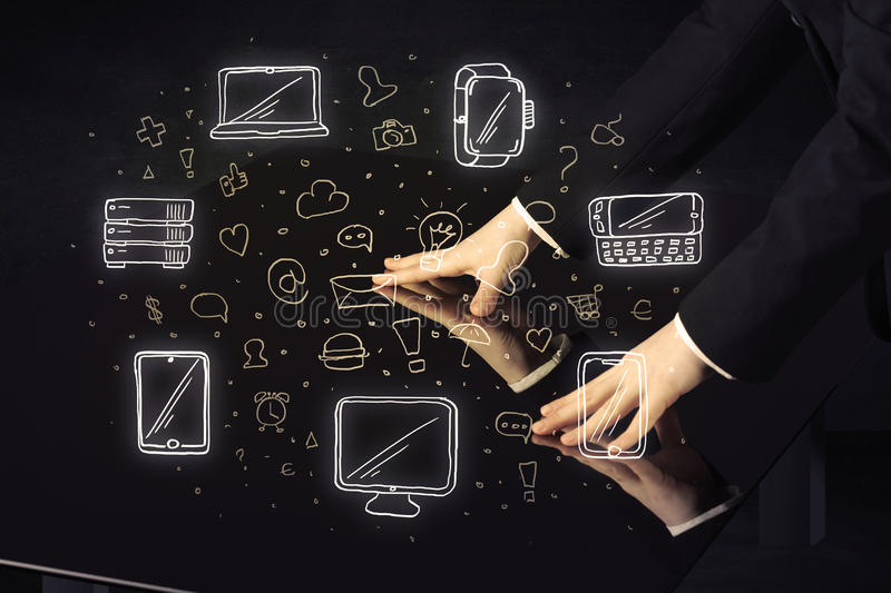 Man pressing table tablet hand touch interface with media icons stock images