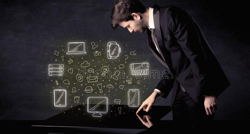 Man pressing table tablet hand touch interface with media icons royalty free stock photos