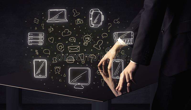Man pressing table tablet hand touch interface with media icons royalty free stock photography