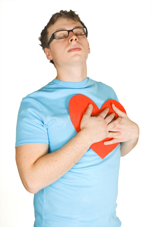 Man pressing to bosom red paper heart royalty free stock photo