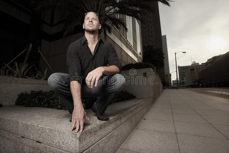 Man Pretending To Be A Gargoyle Royalty Free Stock Photography