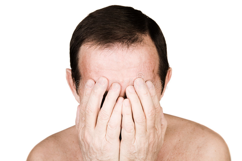 Man in problem or impotent. Isolated person on white background, selective focus on nearest part of body royalty free stock photography