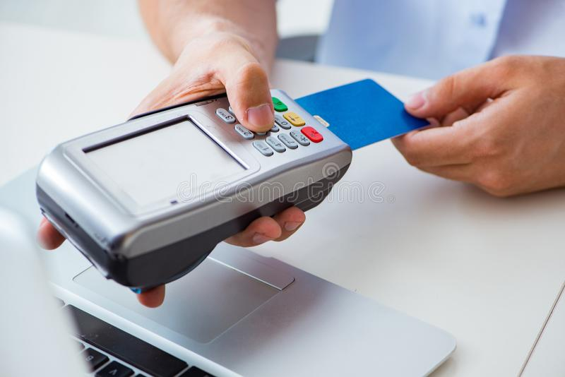 The man processing credit card transaction with pos terminal royalty free stock images