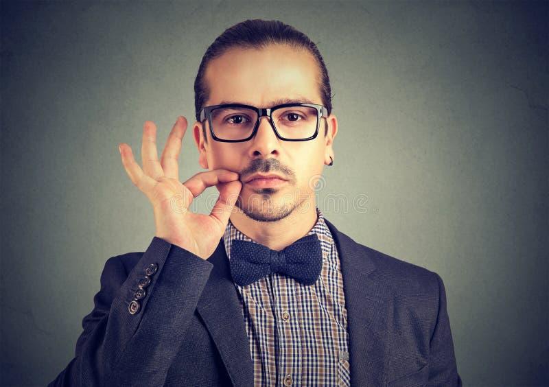 Man promising to keep secret stock photos