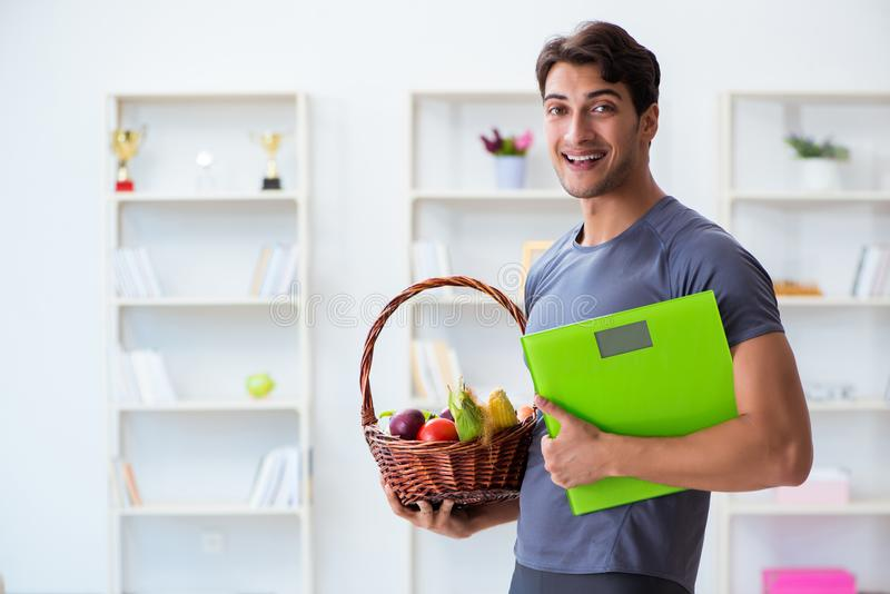 The man promoting the benefits of healthy eating and doing sports stock image