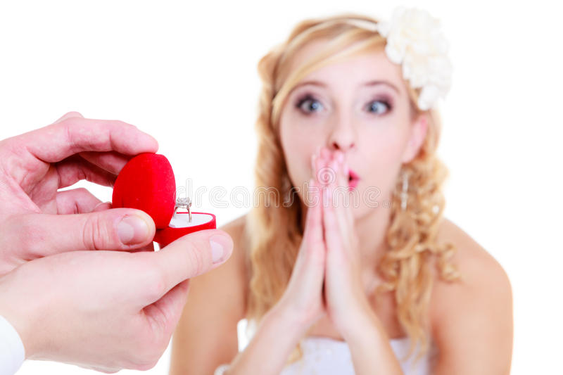 Man proposes to shocked woman stock photography
