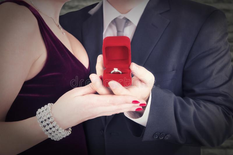Man proposing engagement ring to his fiancee. royalty free stock photography
