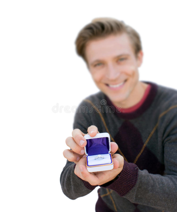 Man proposing. Man kneeling down and proposing - focus on ring isolated on white royalty free stock images