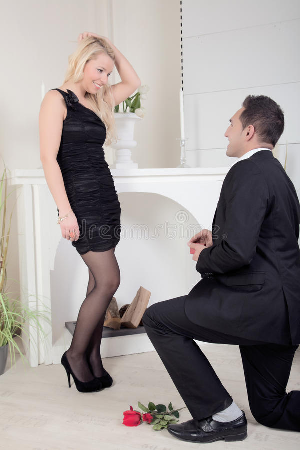 Man proposing kneeling on the floor royalty free stock photography