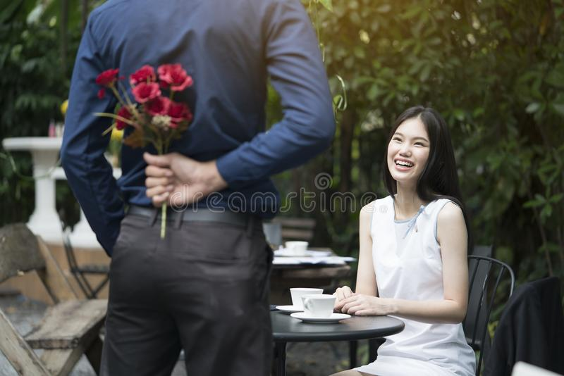 A man is proposing marriage to a smiling woman royalty free stock images