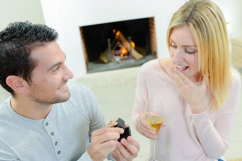 Man proposing to girlfriend. Man proposing to his girlfriend stock photography