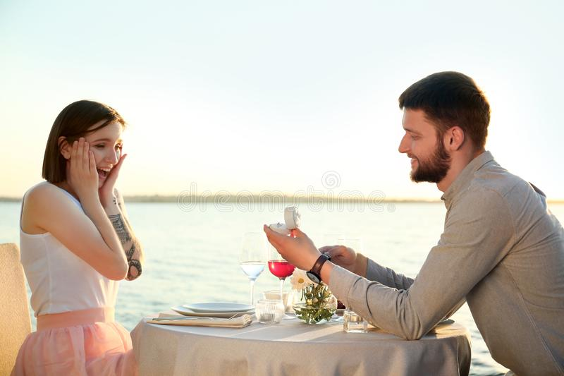 Man proposing to his beloved near river royalty free stock photos