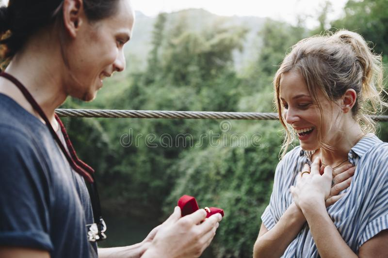 Man proposing to his girlfriend stock images