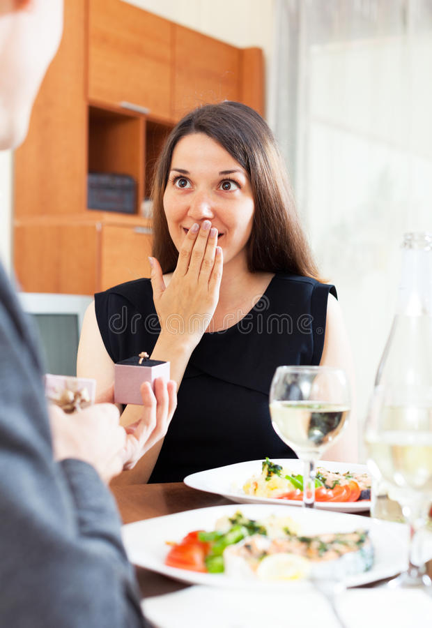 Man proposing to his girlfriend. While they are having romantic dinner royalty free stock images