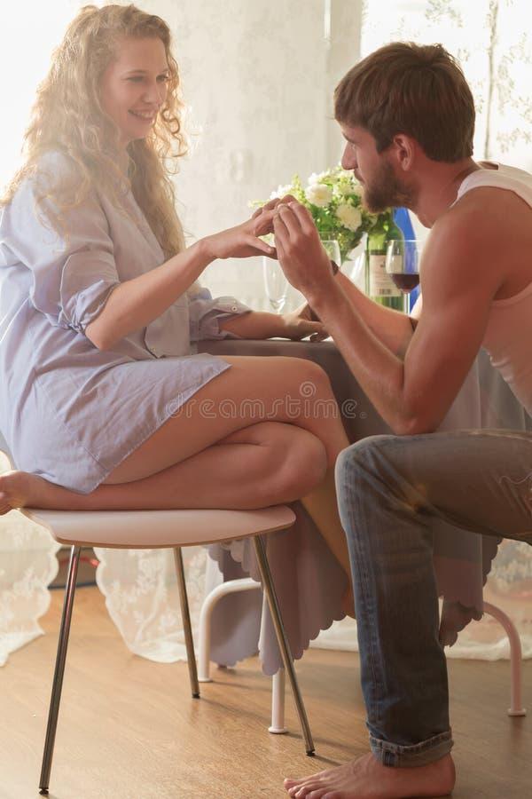Man proposing to his girlfriend stock image