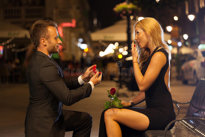 Man proposing to his lover. In the city stock photography