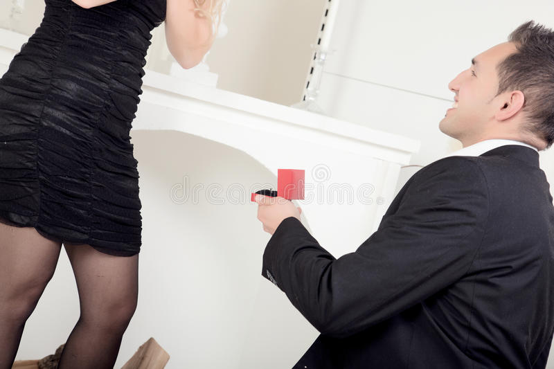 Man proposing to his sweetheart stock images