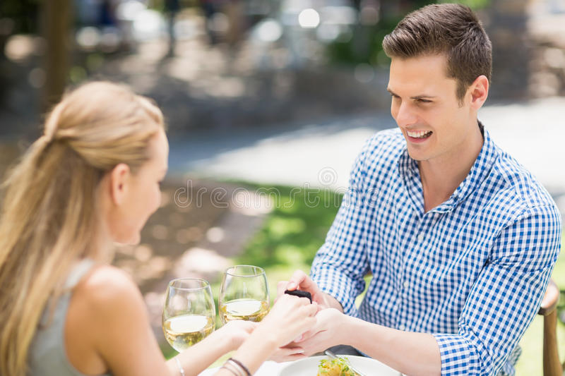 Man proposing to woman offering engagement ring royalty free stock photos