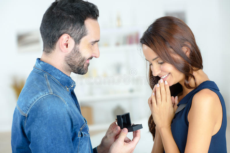 Man proposing to woman with ring. Man proposing to women with a ring stock images