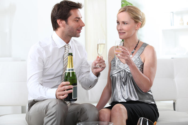 Man proposing a toast. To his female partner royalty free stock photography