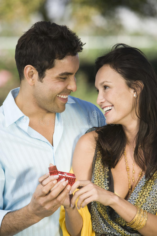Man Proposing Woman. Happy Hispanic Latin men proposing woman stock images