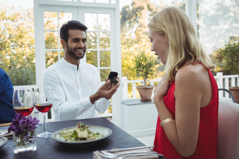 Man proposing woman while having meal. In restaurant royalty free stock photo