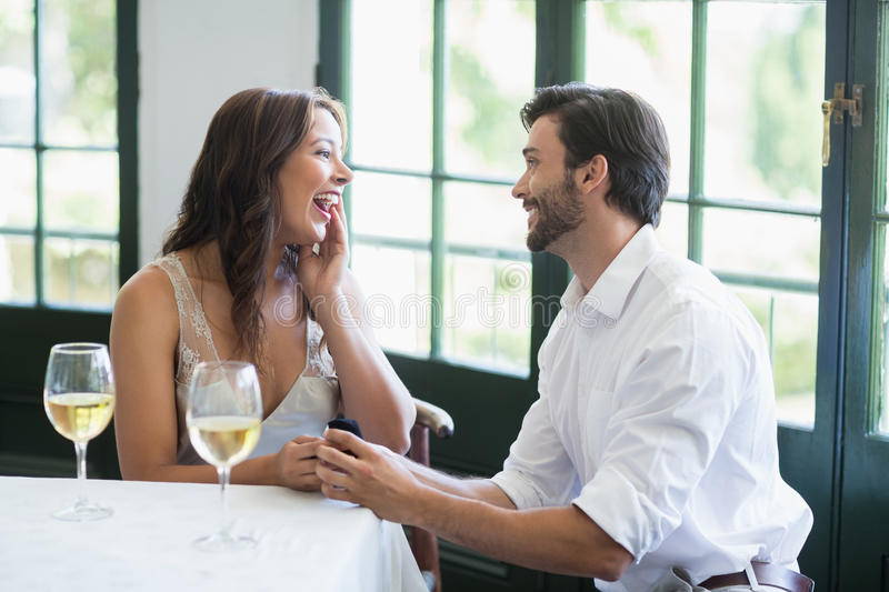Man proposing a woman with a ring. In the restaurant royalty free stock image