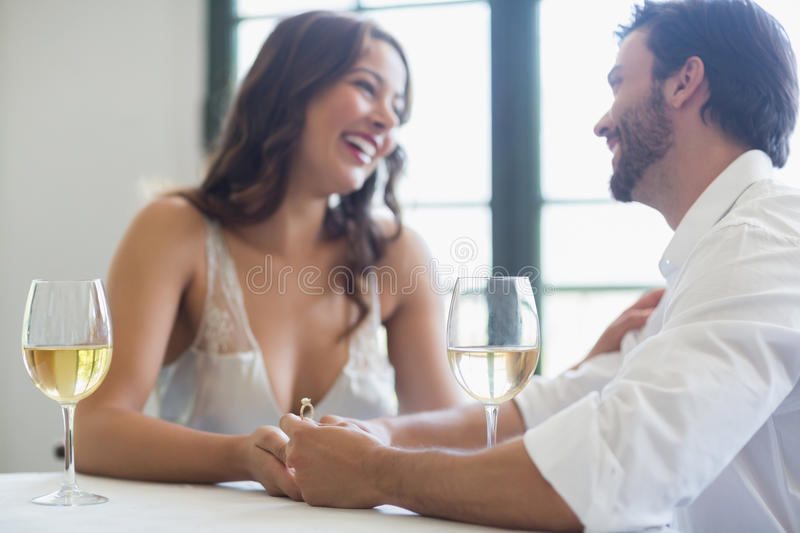 Man proposing a woman with a ring. In the restaurant stock photos