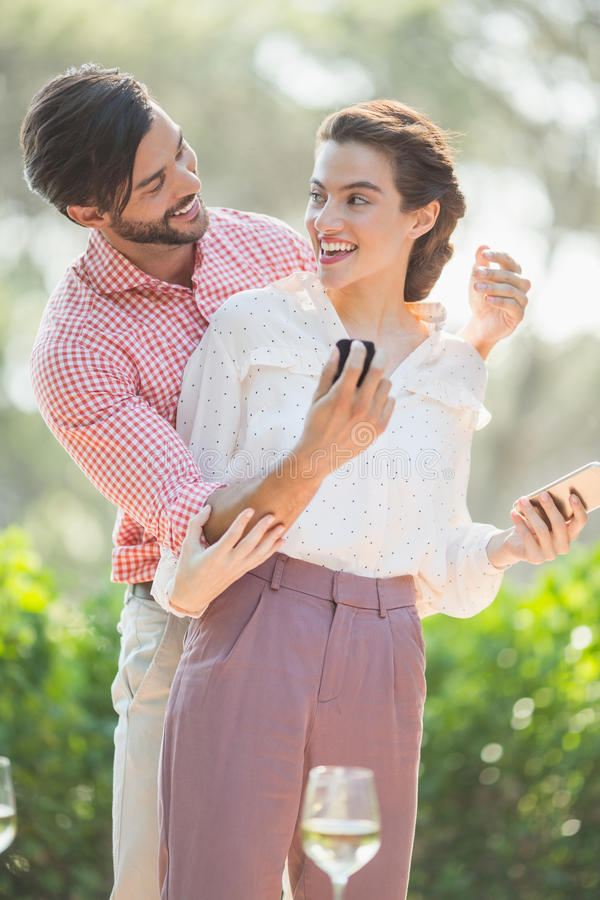 Man proposing a woman with a ring. In the restaurant royalty free stock photos