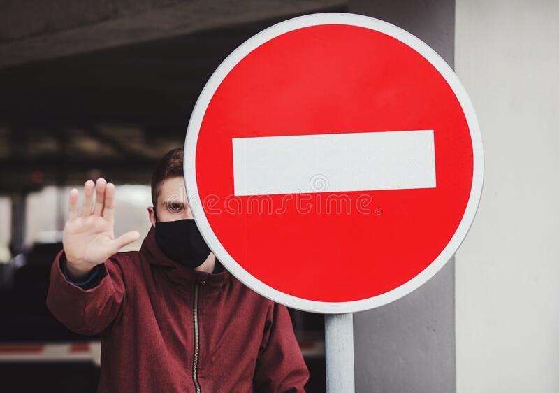 Man in protective mask showing gesture stop. Stop the virus and epidemic diseases. Man in black protective mask showing gesture stop stock photography