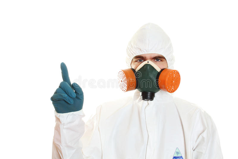 Man in protective suit. A mask and a respirator. Isolated on white royalty free stock photography