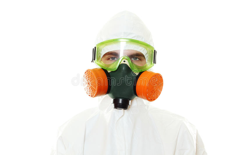 Man in protective suit. A mask and a respirator. Isolated on white stock photos