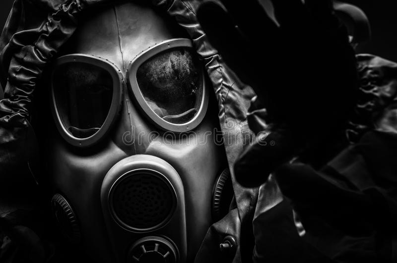 Man in protective suit. Against dark background royalty free stock photos