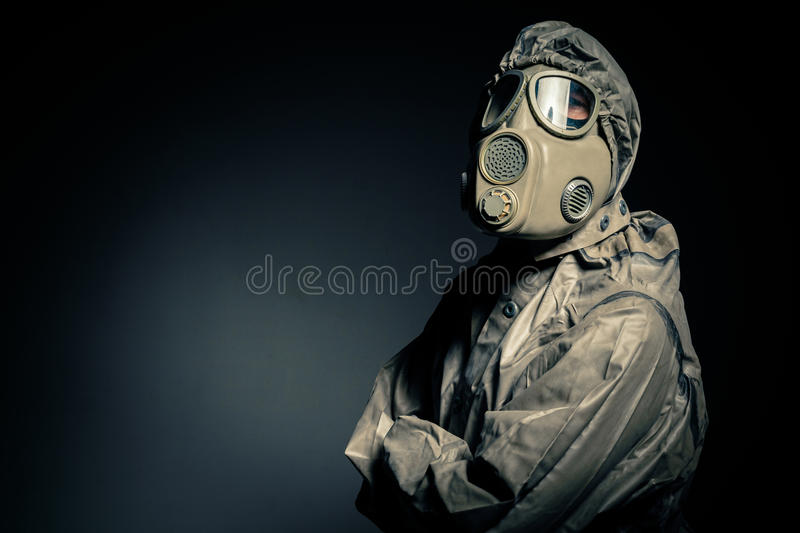 Man in protective suit. Against black background stock images