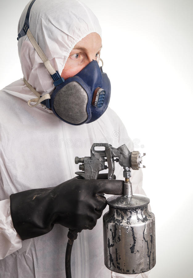 Man in protective suit. Gloves, paintpistol and a respiraton royalty free stock image