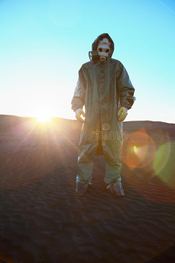 Man In Protective Suit And Rays Of Sun Stock Image