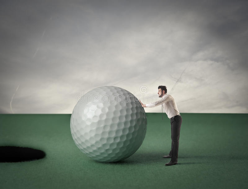 Man pulling a golf ball royalty free stock images