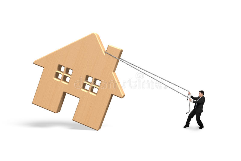 Man pulling rope to move wooden house. On white royalty free stock images