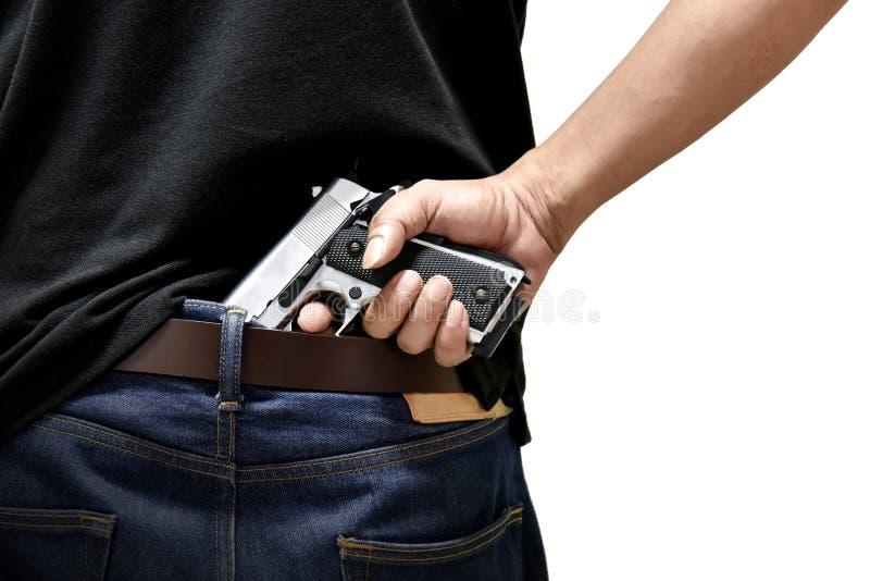 The man pulls out a gun stock photos