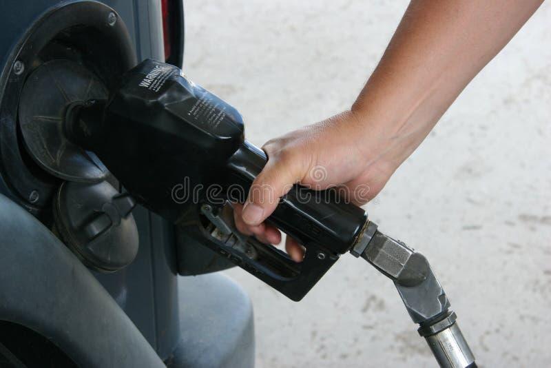 Man Pumping Gas stock photos